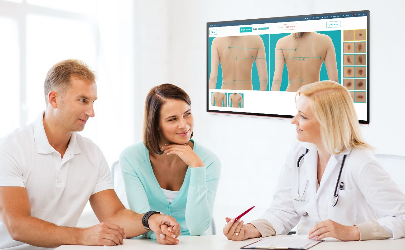 Dermatologist using DermEngine to discuss full body images with patients