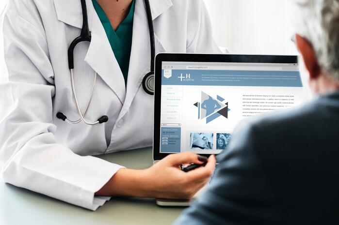 Doctor showing patient their electronic health record for enhanced engagement-1
