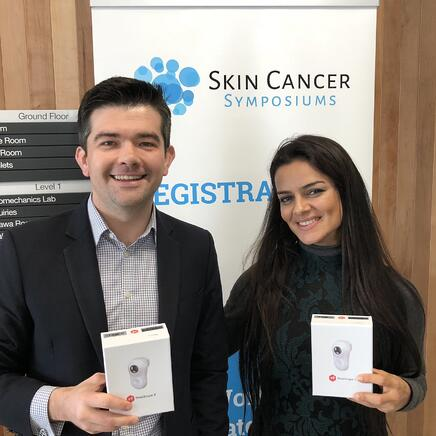 Peter Birch and Maryam Sadeghi at Skin Cancer Symposiums with MoleScope